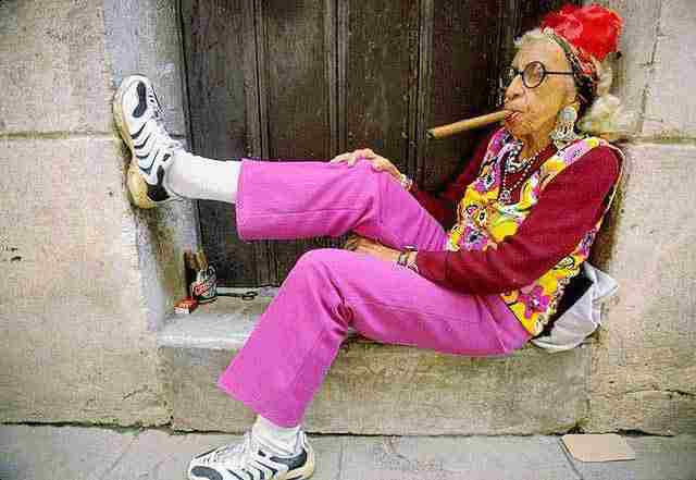 old woman with cigar sitting